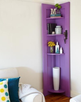 Vintage door + fresh coat of paint = cool purple corner shelf | via http://nz.lifestyle.yahoo.com/better-homes-gardens/diy/how-to/h/-/15635465/how-to-make-shelves-using-an-old-door/